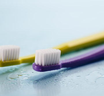 Clean laminates using toothbrush